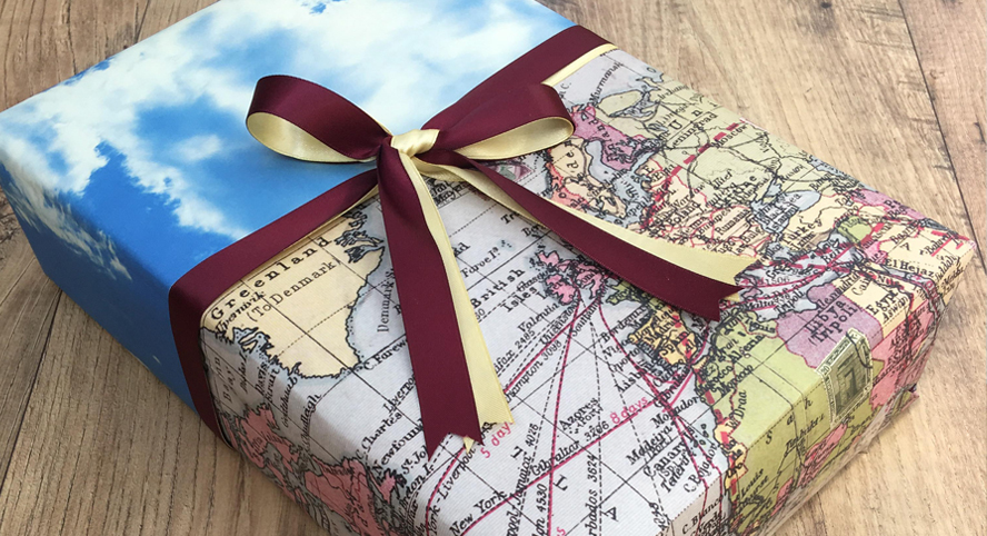 Map themed gift wrapped present for graduates or a traveller....